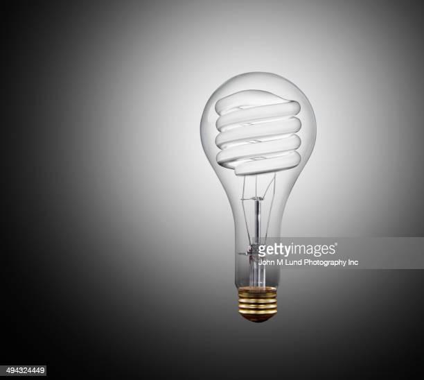 Incandescent light bulb inside of fluorescent bulb