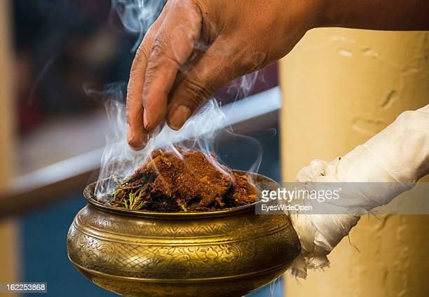 Incense at a teaching of his Holiness the 14th Dalai Lama on November 20 2012 in Dharamsala Mcleod Ganj India The buddhistic event took place at the...