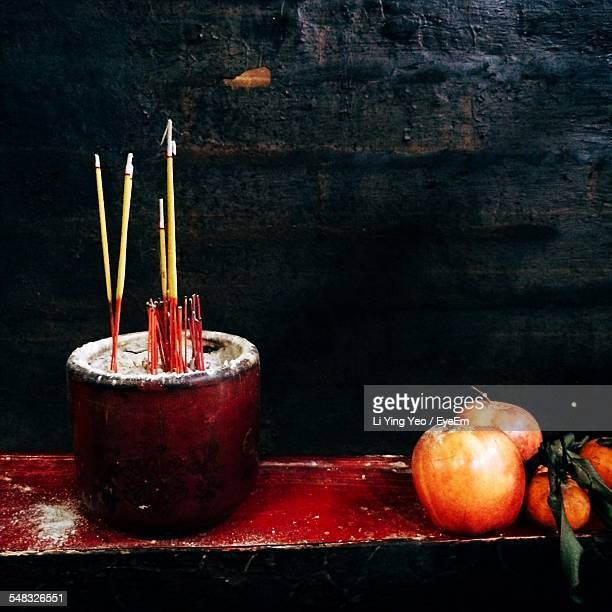 Incense Sticks Burning Near Apples