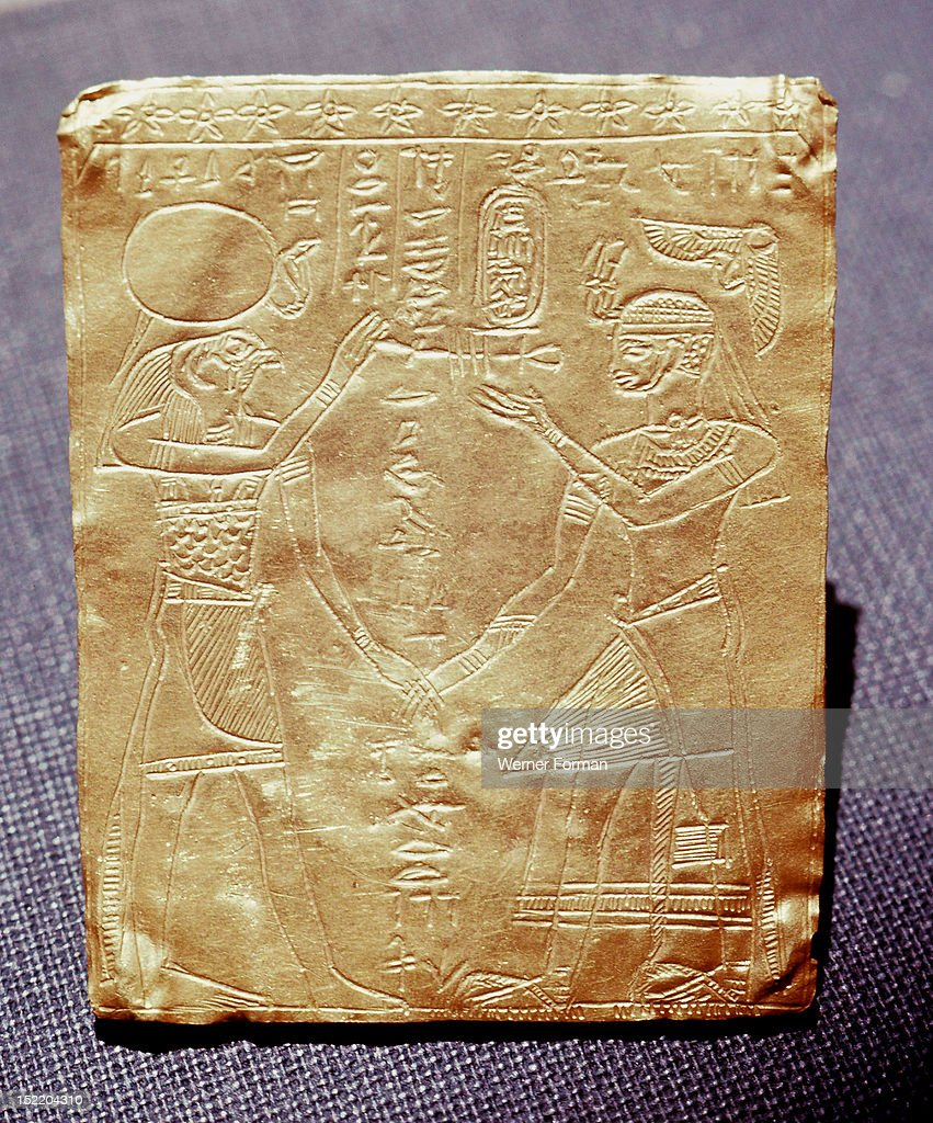 Incised gold plaque depicting a Meroitic king honouring the Egyptian god Horus,The king is symbollically equated to the falcon god in his aspect as Re Herakhty, Horus of the Horizon. Sudan. Nubian. Meroe or Napata.