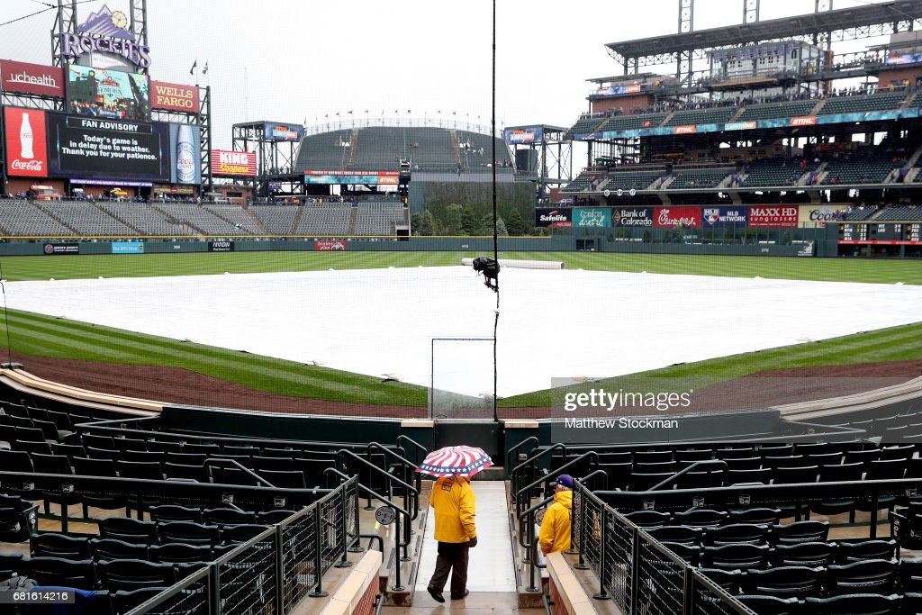 Inclement weather delays the start of play between the Chicago Cubs verses the Coloarado Rockies at Coors Field on May 10, 2017 in Denver, Colorado.