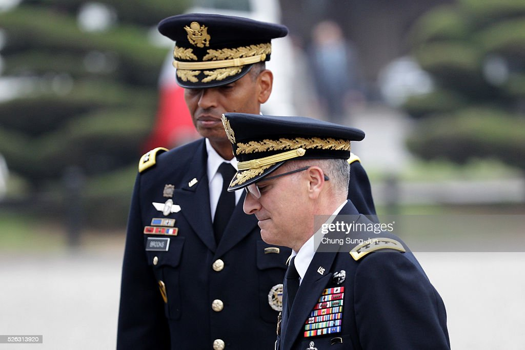 Incoming commander of United Nations Command (UNC), Combined Forces Command (CFC), and United States Forces Korea (USFK), U.S. Gen. Vincent Brooks (L) attends with outgoing commander Gen. Curtis Scaparrotti (R) during a change-of-command ceremony at the Yonsan U.S. army base on April 30, 2016 in Seoul, South Korea. Brooks will succeed Gen. Curtis Scaparrotti, who had led 28,500 U.S. troops stationed in South Korea.