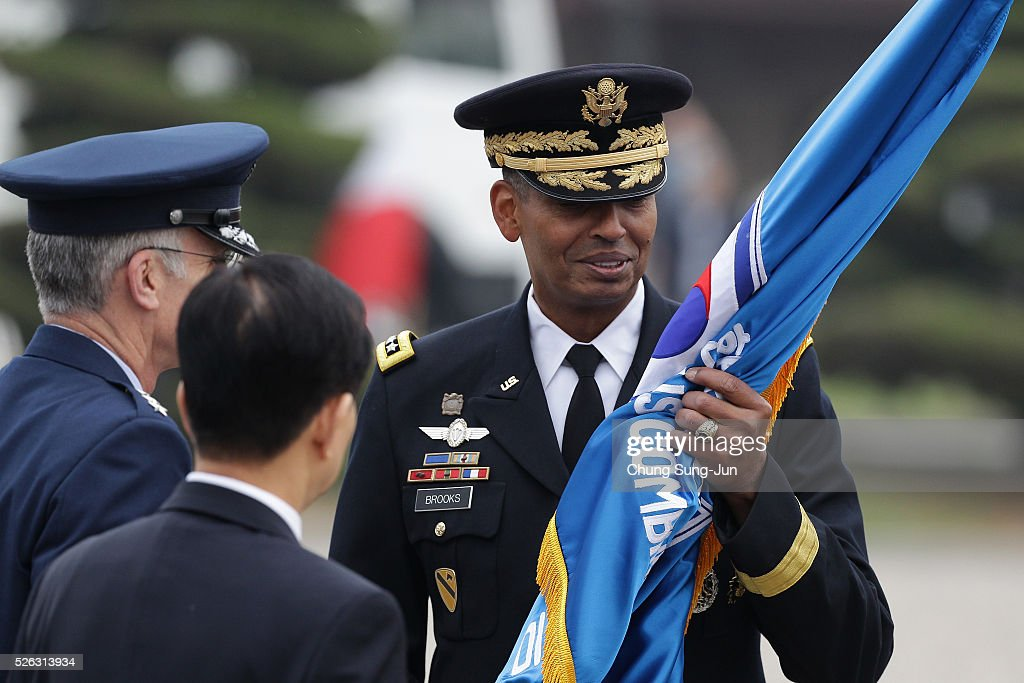 Incoming commander of United Nations Command (UNC), Combined Forces Command (CFC), and United States Forces Korea (USFK), U.S. Gen. Vincent Brooks (R) receives the South Korea-US Combined Forces Command (CFC) flag from U.S. Gen. Paul Selva (L) the vice chairman of the joint chiefs of staff during a change-of-command ceremony at the Yonsan U.S. army base on April 30, 2016 in Seoul, South Korea. Brooks will succeed Gen. Curtis Scaparrotti, who had led 28,500 U.S. troops stationed in South Korea.