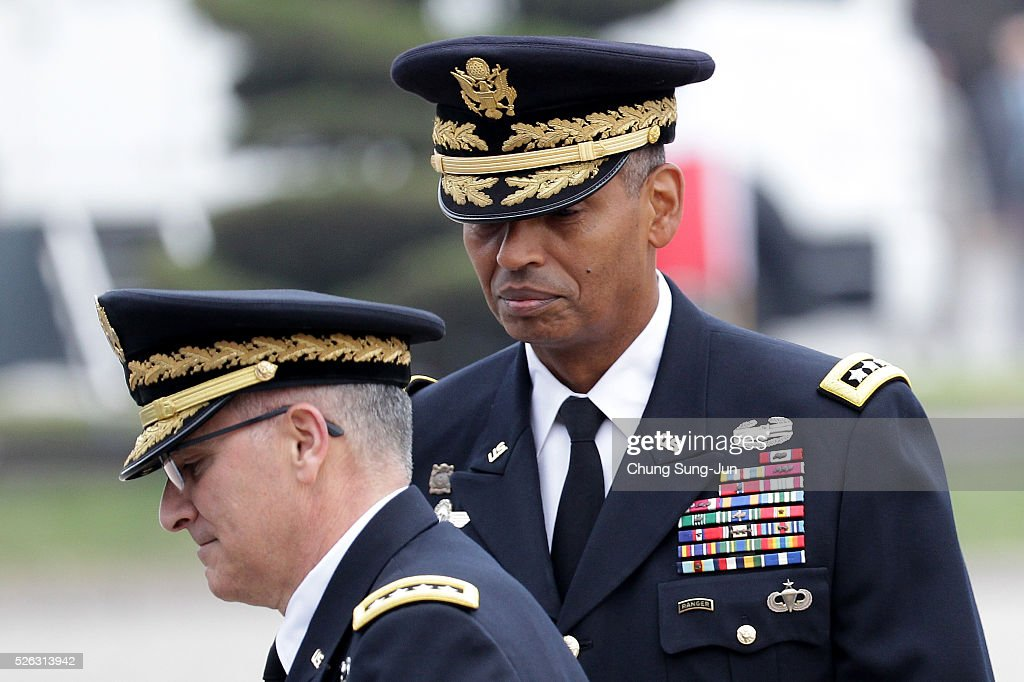 Incoming commander of United Nations Command (UNC), Combined Forces Command (CFC), and United States Forces Korea (USFK), U.S. Gen. Vincent Brooks (R) attends with outgoing commander Gen. Curtis Scaparrotti (L) during a change-of-command ceremony at the Yonsan U.S. army base on April 30, 2016 in Seoul, South Korea. Brooks will succeed Gen. Curtis Scaparrotti, who had led 28,500 U.S. troops stationed in South Korea.