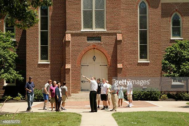 Incoming freshmen take a tour of the RandolphMacon College campus on July 13 2014 in the town of Ashland Virginia The college sits beside the...