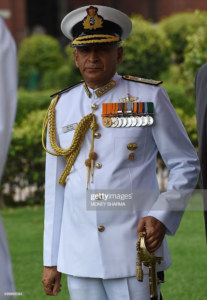 Incoming Indian Navy Chief Admiral Sunil Lanba looks on after inspecting a guard of honour at a ceremony in New Delhi on May 31, 2016. Admiral Lanba is scheduled to have a three-year-term in office till May 31, 2019. / AFP / MONEY