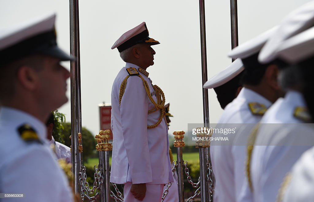 Incoming Indian Navy Chief Admiral Sunil Lanba prepares to inspect a guard of honour at a ceremony in New Delhi on May 31, 2016. Admiral Lanba is scheduled to have a three-year-term in office till May 31, 2019. / AFP / MONEY
