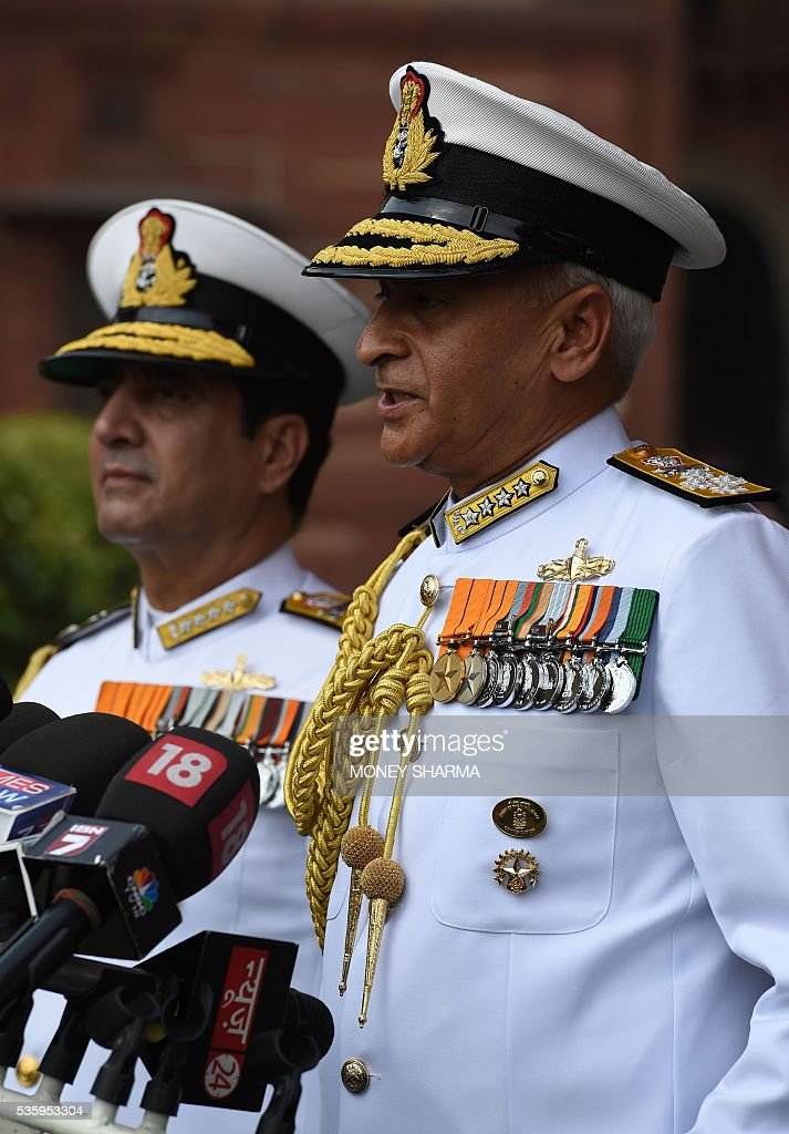 Incoming Indian Navy Chief Admiral Sunil Lanba(R)is accompanied by his predecessor Admiral R.K.Dhowan as he addresses media representatives after inspecting a guard of honour at a ceremony in New Delhi on May 31, 2016. Admiral Lanba is scheduled to have a three-year-term in office till May 31, 2019. / AFP / MONEY