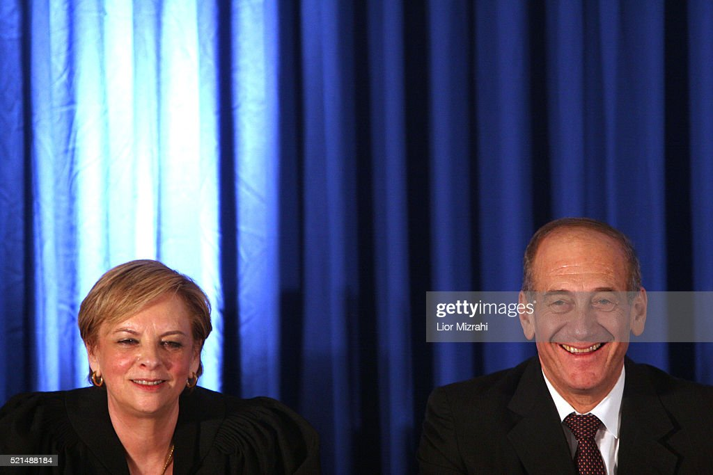 Incoming Israeli Supreme Court president Dorit Beinish (L) and Prime Minister <a gi-track='captionPersonalityLinkClicked' href=/galleries/search?phrase=Ehud+Olmert&family=editorial&specificpeople=178946 ng-click='$event.stopPropagation()'>Ehud Olmert</a> smile at her swearing-in ceremony in the parliament in Jerusalem on Thursday September 14, 2006.