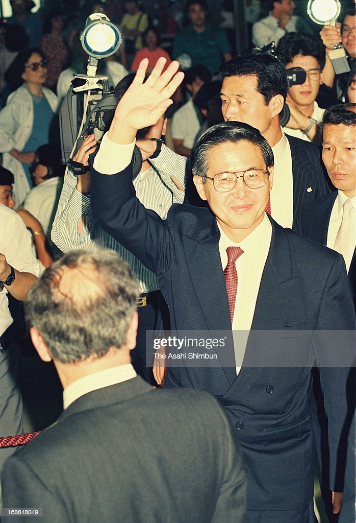 Incoming Peruvian President <a gi-track='captionPersonalityLinkClicked' href=/galleries/search?phrase=Alberto+Fujimori&family=editorial&specificpeople=206244 ng-click='$event.stopPropagation()'>Alberto Fujimori</a> waves upon departure at New Tokyo International Airport on July 5, 1990 in Narita, Chiba, Japan. Narita Airport is to mark 35th anniversary of its official opening on May 20. The construction of the international airport had often been suspended by bloody protests of landowners and left wing activists and students amid Japan's rapid economic growth and radicalism in 1970s.