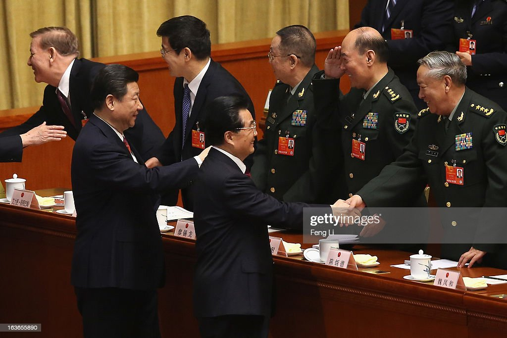 Incoming President Xi Jinping (Front Left) follows behind the outgoing Chinese President Hu Jintao (Front Right) to attend the fourth plenary meeting of the National People's Congress at the Great Hall of the People on March 14, 2013 in Beijing, China. Xi Jinping, general secretary of the Communist Party of China Central Committee, was elected President of the People's Republic of China and Chairman of the Central Military Commission on Thursday.