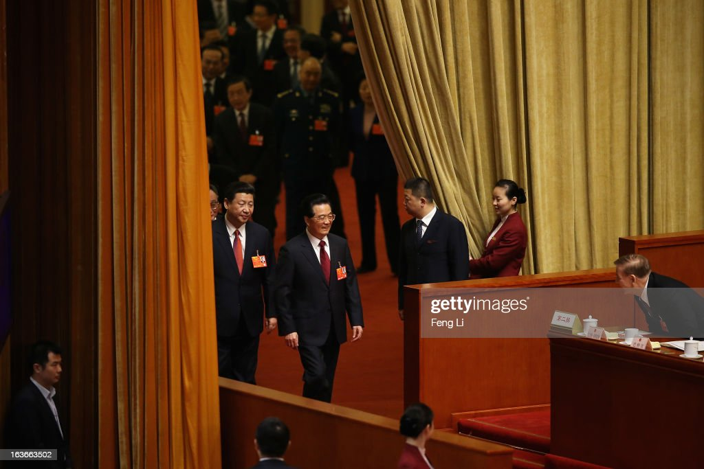 Incoming President <a gi-track='captionPersonalityLinkClicked' href=/galleries/search?phrase=Xi+Jinping&family=editorial&specificpeople=2598986 ng-click='$event.stopPropagation()'>Xi Jinping</a> follows behind the outgoing Chinese President <a gi-track='captionPersonalityLinkClicked' href=/galleries/search?phrase=Hu+Jintao&family=editorial&specificpeople=203109 ng-click='$event.stopPropagation()'>Hu Jintao</a> (Front) to attend the fourth plenary meeting of the National People's Congress at the Great Hall of the People on March 14, 2013 in Beijing, China. <a gi-track='captionPersonalityLinkClicked' href=/galleries/search?phrase=Xi+Jinping&family=editorial&specificpeople=2598986 ng-click='$event.stopPropagation()'>Xi Jinping</a>, general secretary of the Communist Party of China Central Committee, was elected President of the People's Republic of China and Chairman of the Central Military Commission on Thursday.