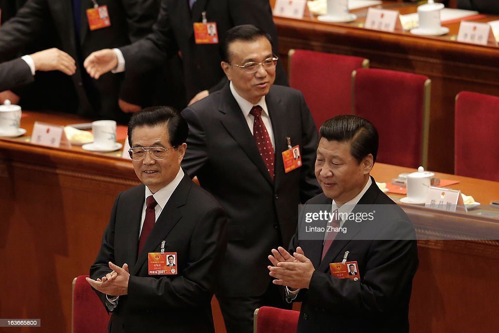 Incoming President Xi Jinping (Front Right) follows behind the outgoing Chinese President Hu Jintao (Front Left) and Chinese Vice Premier Li Keqiang to attend the fourth plenary meeting of the National People's Congress at the Great Hall of the People on March 14, 2013 in Beijing, China. Xi Jinping, general secretary of the Communist Party of China Central Committee, was elected President of the People's Republic of China and Chairman of the Central Military Commission on Thursday.