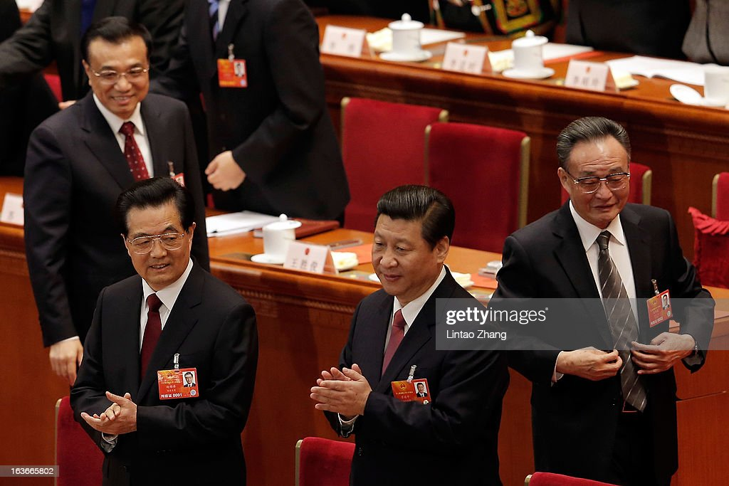 Incoming President Xi Jinping (2nd-Right) follows behind the outgoing Chinese President Hu Jintao (Front Left) to attend the fourth plenary meeting of the National People's Congress at the Great Hall of the People on March 14, 2013 in Beijing, China. Xi Jinping, general secretary of the Communist Party of China Central Committee, was elected President of the People's Republic of China and Chairman of the Central Military Commission on Thursday.