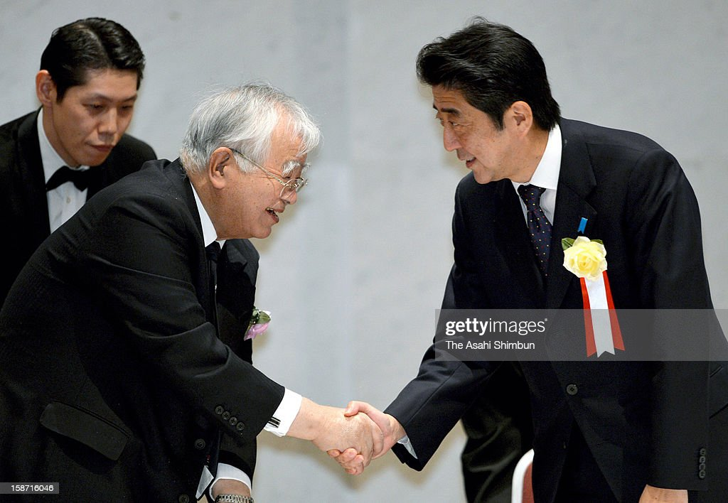 Incoming Prime Minister Shinzo Abe and Keidanren, Japan Business Federation chair Hiromasa Yonekura shake hands during their meeting on December 25, 2012 in Tokyo, Japan. Shinzo Abe of Liberal Democratic Party will be appointed as the new Japanese Prime Minister on December 26.