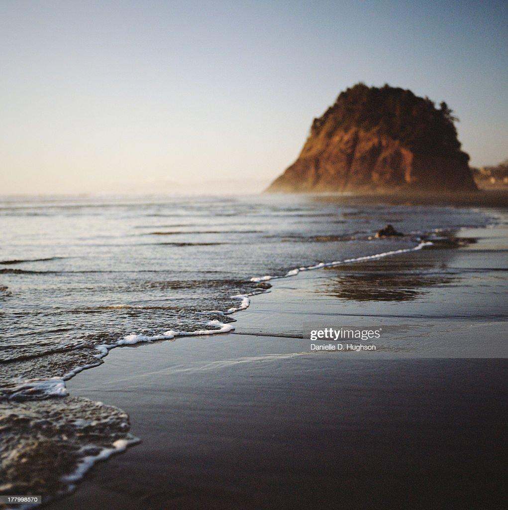 Incoming Tide And Island On Oregon Coast