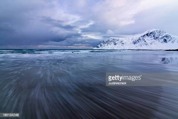 Incoming Wave on Beach with Mountain