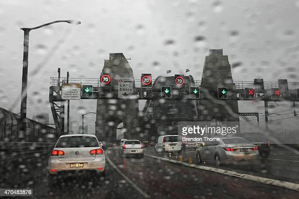 Increased traffic is seen over the Sydney Harbour Bridge due to the wild weather on April 21 2015 in Sydney Australia A second day of damaging winds...