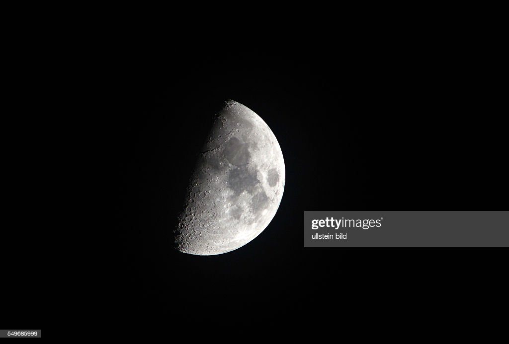 increasing MOON/half moon at the evening sky