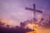 Transparent cross symbol of religion over dramatic sky