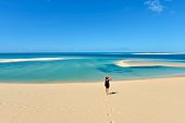 A young woman is in awe with spectacular views from Bazaruto Archipelago in Mozambique, East Africa.