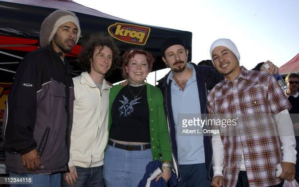 Incubus with winner Letha Zamora during KROQ Award Honda Civic Si Custom Designed By Incubus at The Forum in Inglewood California United States