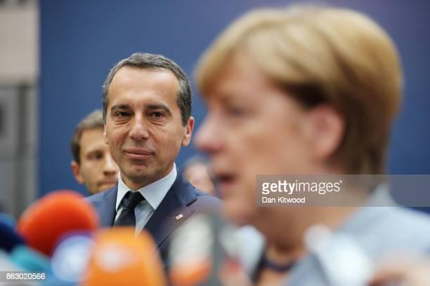 Incumbent Austrian Chancellor Christian Kern greets German Chancellor Angela Merkel ahead of a European Council Meeting at the Council of the...
