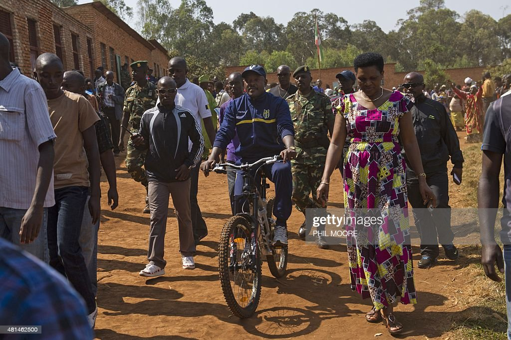 Incumbent Burundi President <a gi-track='captionPersonalityLinkClicked' href=/galleries/search?phrase=Pierre+Nkurunziza&family=editorial&specificpeople=563215 ng-click='$event.stopPropagation()'>Pierre Nkurunziza</a> (C) arrives by bicycle to cast his ballot at a polling station in his native village of Buye in Ngozi province, northern Burundi, on July 21, 2015. A former sports teacher, ex-rebel, born-again Christian and football fanatic, Burundi President <a gi-track='captionPersonalityLinkClicked' href=/galleries/search?phrase=Pierre+Nkurunziza&family=editorial&specificpeople=563215 ng-click='$event.stopPropagation()'>Pierre Nkurunziza</a> has divided the nation over his bid to secure a third term in office in elections on JUly 21.