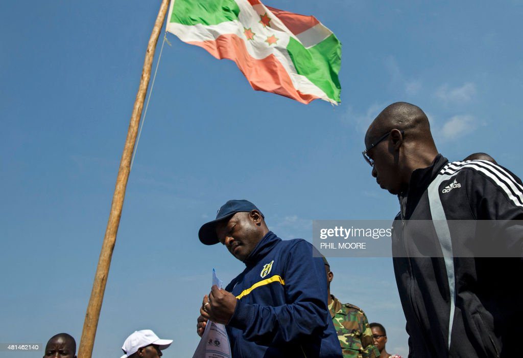 Incumbent Burundi President <a gi-track='captionPersonalityLinkClicked' href=/galleries/search?phrase=Pierre+Nkurunziza&family=editorial&specificpeople=563215 ng-click='$event.stopPropagation()'>Pierre Nkurunziza</a> (C) lines up prior to casting his ballot at a polling station in his native village of Buye in Ngozi province, northern Burundi, on July 21, 2015. A former sports teacher, ex-rebel, born-again Christian and football fanatic, Burundi President <a gi-track='captionPersonalityLinkClicked' href=/galleries/search?phrase=Pierre+Nkurunziza&family=editorial&specificpeople=563215 ng-click='$event.stopPropagation()'>Pierre Nkurunziza</a> has divided the nation over his bid to secure a third term in office in elections on July 21.
