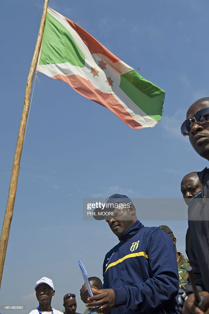 Incumbent Burundi President <a gi-track='captionPersonalityLinkClicked' href=/galleries/search?phrase=Pierre+Nkurunziza&family=editorial&specificpeople=563215 ng-click='$event.stopPropagation()'>Pierre Nkurunziza</a> lines up prior to casting his ballot at a polling station in his native village of Buye in Ngozi province, northern Burundi, on July 21, 2015. A former sports teacher, ex-rebel, born-again Christian and football fanatic, Burundi President <a gi-track='captionPersonalityLinkClicked' href=/galleries/search?phrase=Pierre+Nkurunziza&family=editorial&specificpeople=563215 ng-click='$event.stopPropagation()'>Pierre Nkurunziza</a> has divided the nation over his bid to secure a third term in office in elections on July 21.