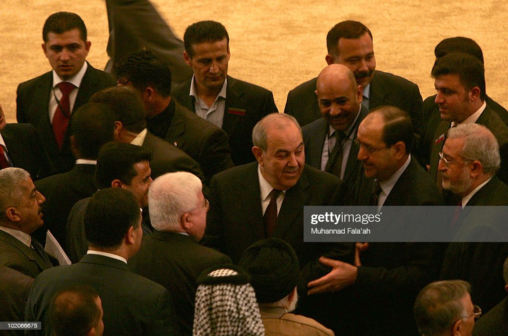 Incumbent Iraqi Prime minister Nuri al-Maliki (2nd R) is seen next to former Prime Minister Iyad Allawi (3rd R) after the first Parliament session on June 14, 2010 at the Green Zone in Baghdad, Iraq. The Iraqi parliament convened for the first time since elections in March where former Prime Minister Iyad Allawi led Iraqiya, a cross sectarian alliance to the most seats but short of a majority to form government. Incumbent Prime Minister, Nuri al-Maliki is hoping to remain in power by forming a government with other Shi'ite parties, including followers of anti-American cleric Moqtada al-Sadr.