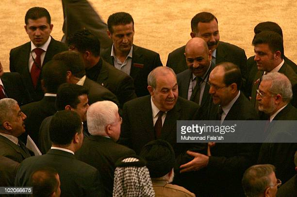 Incumbent Iraqi Prime minister Nuri alMaliki is seen next to former Prime Minister Iyad Allawi after the first Parliament session on June 14 2010 at...