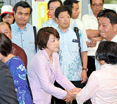 Incumbent state minister for Okinawa and Northern Territories Affairs Aiko Shimajiri of the Liberal Democratic Party shakes hands with her supporter...