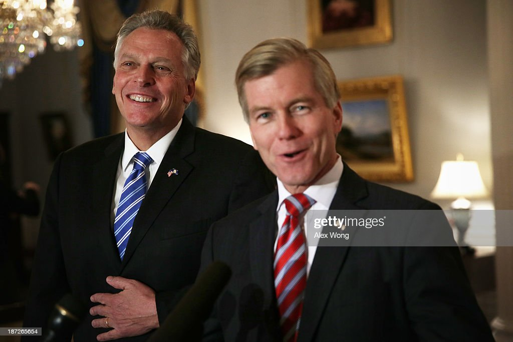 Incumbent Virginia Governor <a gi-track='captionPersonalityLinkClicked' href=/galleries/search?phrase=Bob+McDonnell&family=editorial&specificpeople=6369061 ng-click='$event.stopPropagation()'>Bob McDonnell</a> (R) and Governor-elect <a gi-track='captionPersonalityLinkClicked' href=/galleries/search?phrase=Terry+McAuliffe&family=editorial&specificpeople=206776 ng-click='$event.stopPropagation()'>Terry McAuliffe</a> speak to members of the media at the Executive Mansion November 7, 2013 in Richmond, Virginia. Governor McDonnell hosted Governor-elect McAuliffe, who will succeed him as the next governor of the commonwealth, with a private lunch, and followed with a joint press availability to answer questions from the media.
