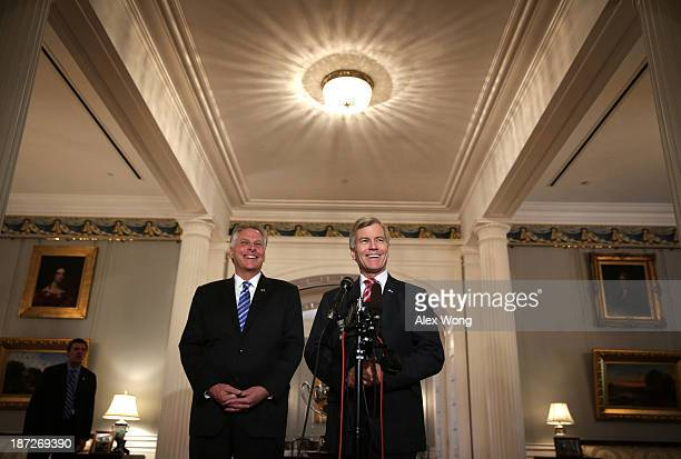 Incumbent Virginia Governor Bob McDonnell and Governorelect Terry McAuliffe speak to members of the media at the Executive Mansion November 7 2013 in...