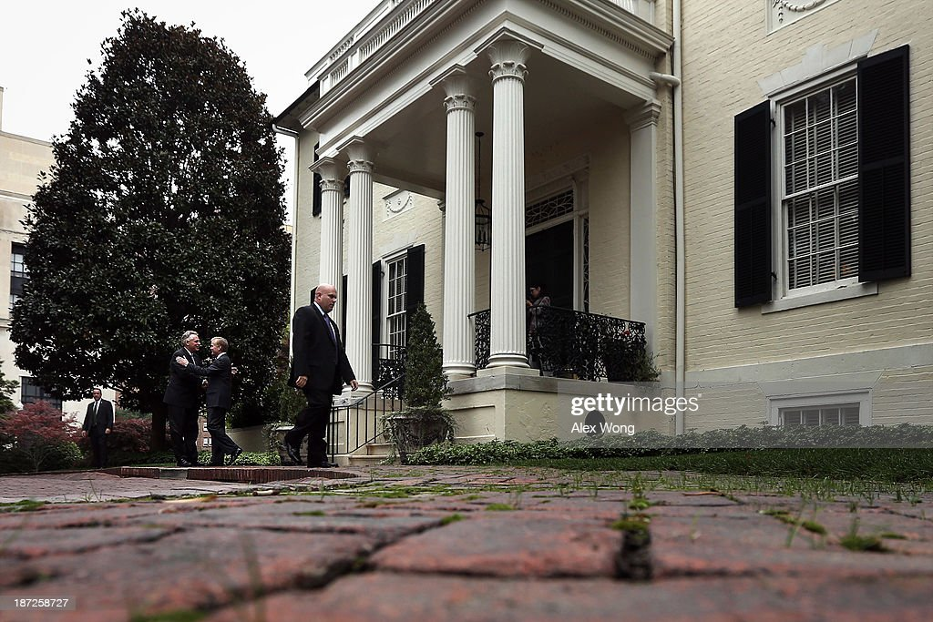Incumbent Virginia Governor <a gi-track='captionPersonalityLinkClicked' href=/galleries/search?phrase=Bob+McDonnell&family=editorial&specificpeople=6369061 ng-click='$event.stopPropagation()'>Bob McDonnell</a> (R) greets Governor-elect <a gi-track='captionPersonalityLinkClicked' href=/galleries/search?phrase=Terry+McAuliffe&family=editorial&specificpeople=206776 ng-click='$event.stopPropagation()'>Terry McAuliffe</a> (L) upon McAuliffe's arrival at the Executive Mansion November 7, 2013 in Richmond, Virginia. Governor McDonnell hosted Governor-elect McAuliffe, who will succeed him as the next governor of the commonwealth, with a private lunch, and followed with a joint press availability to answer questions from the media.