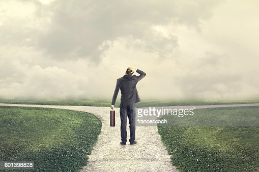 indecisive and lost man chooses the right path : Stock Photo