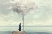 Indecisive woman does not know if climb up a ladder from the sky to a disenchanted destination