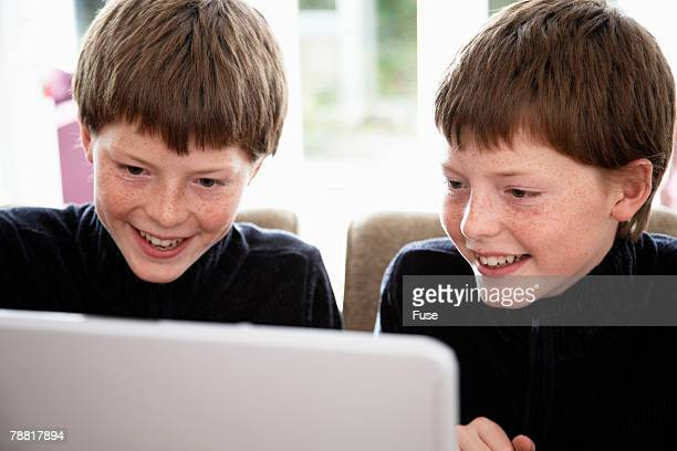 Indentical Twin Pre-teen Boys Using Laptop