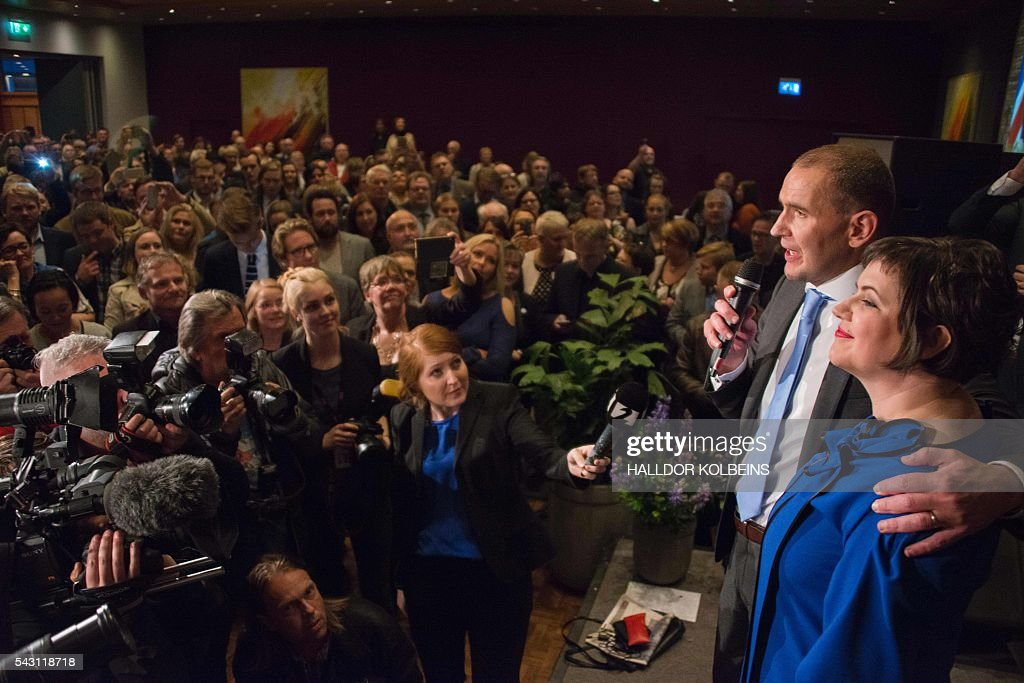 Independant presidential candidate Gudni Johannesson speaks next to his wife Eliza Reid at an election party in Reykjavik, on June 25, 2016. Political newcomer Gudni Johannesson claimed victory in Iceland's presidential election after riding a wave of anti-establishment sentiment, though the vote was eclipsed by the country's eagerly-anticipated and historic Euro football match. / AFP / HALLDOR