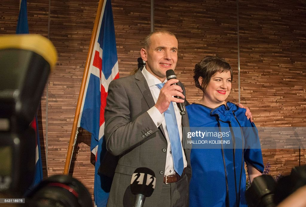 Independant presidential candidate Gudni Johannesson (L) speaks next to his wife Eliza Reid at an election party in Reykjavik, on June 25, 2016. Political newcomer Gudni Johannesson claimed victory in Iceland's presidential election after riding a wave of anti-establishment sentiment, though the vote was eclipsed by the country's eagerly-anticipated and historic Euro football match. / AFP / HALLDOR
