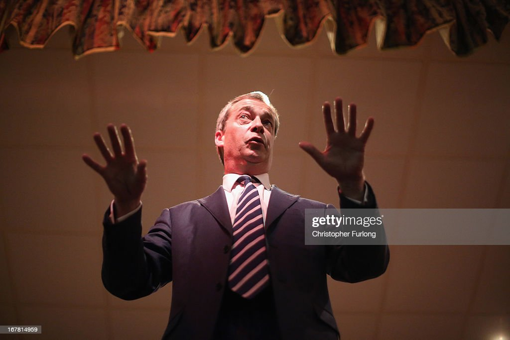 UK Independence Party (UKIP) Leader <a gi-track='captionPersonalityLinkClicked' href=/galleries/search?phrase=Nigel+Farage&family=editorial&specificpeople=697991 ng-click='$event.stopPropagation()'>Nigel Farage</a> addresses members of the public during a political meeting at the Armstrong Hall as he canvasses for votes during the local election on April 30, 2013 in South Shields, England. The UK Independence party leader, <a gi-track='captionPersonalityLinkClicked' href=/galleries/search?phrase=Nigel+Farage&family=editorial&specificpeople=697991 ng-click='$event.stopPropagation()'>Nigel Farage</a>, said that his party faced 'one or two teething problems' with its 17000 candidates for Thursday's local elections after the suspension of UKIP candidate Alex Wood, who was photographed making a Nazi salute.