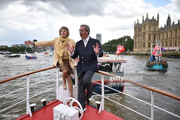 UK Independence party leader Nigel Farage and Labour party MP Kate Hoey pose on a passenger boat as they accompany a Brexit flotilla of fishing boats...