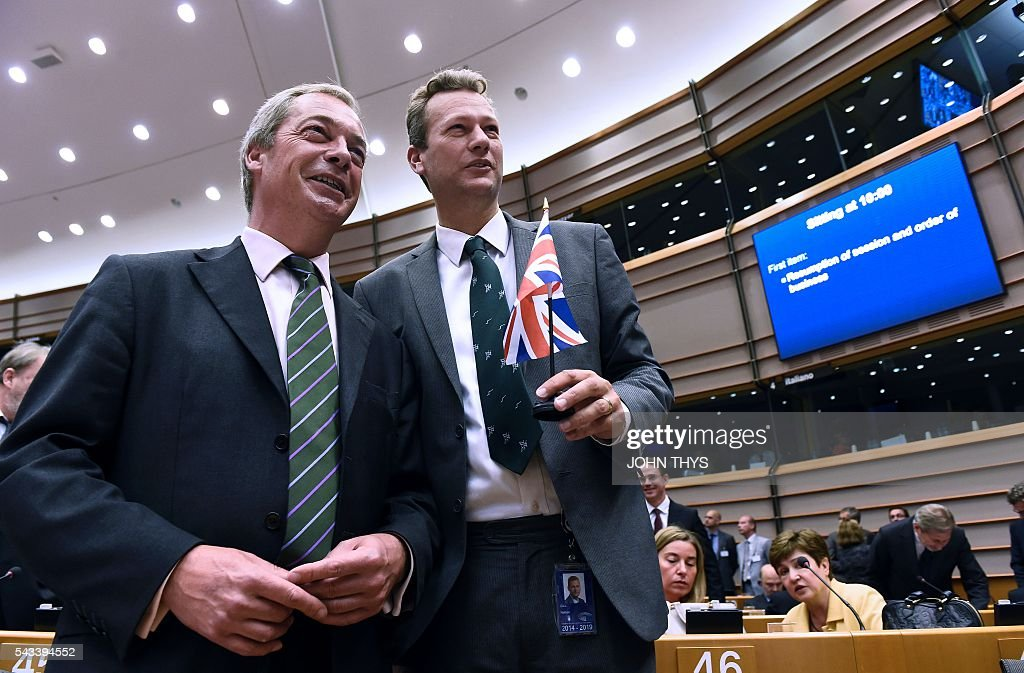 UK Independence Party (UKIP) leader Nigel Farage (L) and UKIP leader in Wales, Nathan Gill, pose for a picture before a plenary session at the EU headquarters in Brussels on June 28, 2016. / AFP / JOHN