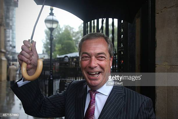 Independence Party leader Nigel Farage arrives at Parliament on October 13 2014 in London England New UKIP Member of Parliament Douglas Carswell has...