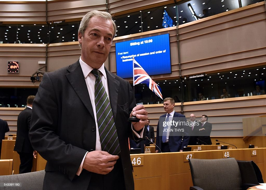 UK Independence Party (UKIP) leader Nigel Farage (L) arrives for a plenary session at the EU headquarters in Brussels on June 28, 2016. European Commission chief Jean-Claude Juncker called on June 28 on Prime Minister David Cameron to clarify quickly when Britain intends to leave the EU, saying there can be no negotiation on future ties before London formally applies to exit. / AFP / JOHN