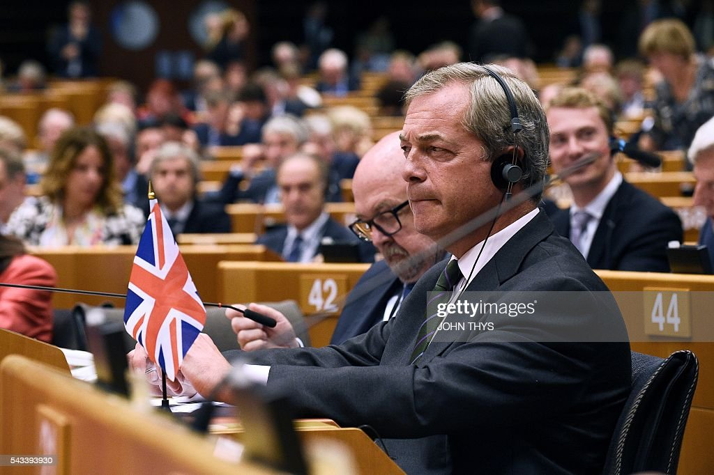 UK Independence Party (UKIP) leader Nigel Farage (L) attends a plenary session at the EU headquarters in Brussels on June 28, 2016. European Commission chief Jean-Claude Juncker called on June 28 on Prime Minister David Cameron to clarify quickly when Britain intends to leave the EU, saying there can be no negotiation on future ties before London formally applies to exit. / AFP / JOHN