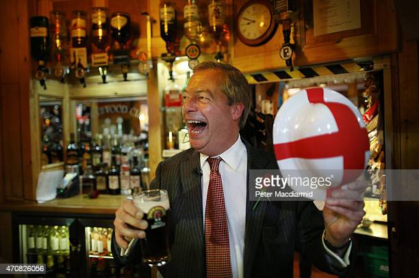 Independence Party leader Nigel Farage celebrates St George's Day with a pint in the Northwood Club after meeting veterans on April 23 2015 in...