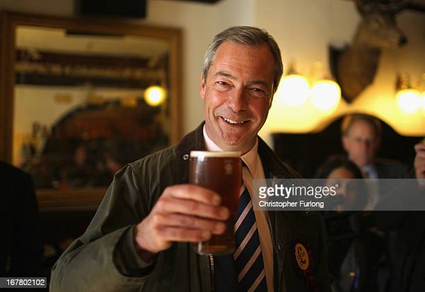 Independence Party Leader Nigel Farage enjoys a pint of beer after canvassing with the party's local candidate for South Shields on April 30 2013 in...