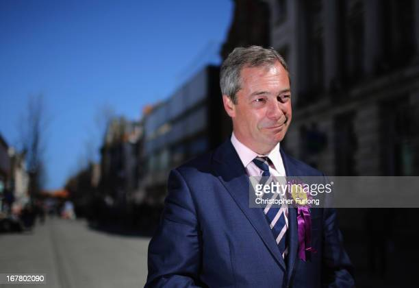 Independence Party Leader Nigel Farage talks to the media as he canvasses for votes in the local elections on April 30 2013 in South Shields England